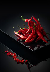 Red hot chili pepper on a black background.