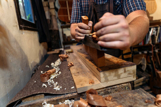 Luthier Working in his Workshop