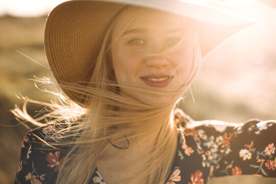 portrait of young cheerful woman with hat