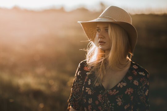 young dreamy woman with hat