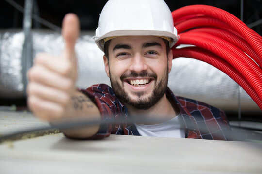 happy builder showing thumbs up at camera