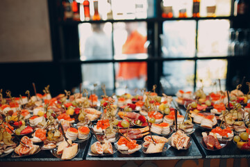 Fototapeta Food catering appetizers snacks on a tray on table. obraz