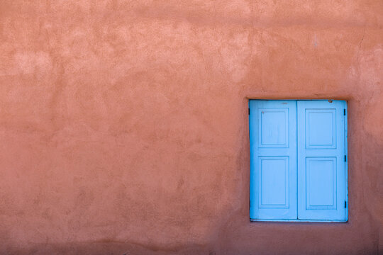 Abstract image of blue window and red adobe wall, Taos, New Mexico