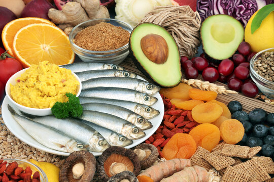 Healthy food for fitness & vitality concept high in antioxidants, protein, omega 3, vitamins, minerals, anthocyanins & fibre. Seafood, vegetables, fruit, cereals, seeds, grains & supplement powders.