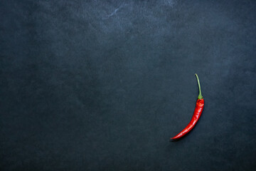 red hot chili pepper on black background