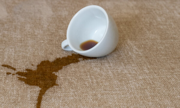 cup spilled coffee dirty spot pour out white stain dry cleaning