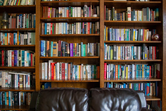 Wooden bookcase filled with books in a UK home setting