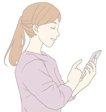 スマホを見る女性の横顔(パステルカラー)