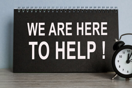 We are here to help, alarm clock, BLACK notebook with text , on blue background, Time running away.