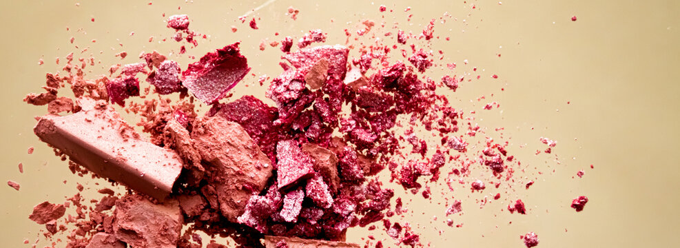 Crushed cosmetics, mineral organic eyeshadow, blush and cosmetic powder isolated on golden background, makeup and beauty banner, flatlay design.