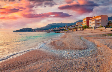 Calm evening view of Himare town. Attractive spring seascape of Adriatic sea. Amazing outdoor scene of Albania, Europe. Traveling concept background.