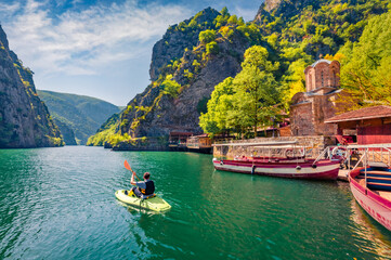 Fototapeta Tourist kayaking on the Matka Canyon. Picturesque morning scene of North Macedonia, Europe. Traveling concept background. obraz