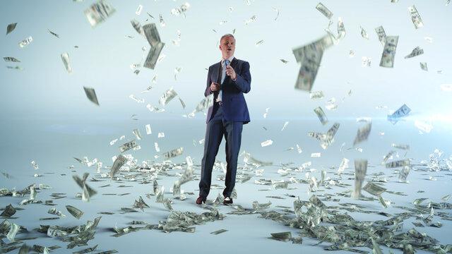 Cheerful businessman dancing under money rain