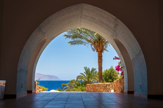 Beautiful arched doorway in a building on the shores of the Red Sea at morning in the resort town of Sharm El Sheikh, Egypt, Africa