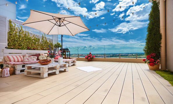 cozy rooftop patio with pallet furniture lounge zone and beautiful landscape view