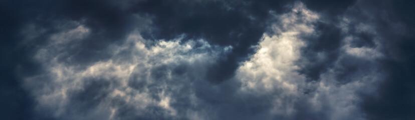 Fototapeta Dramatic dark storm clouds on the sky in wide format obraz
