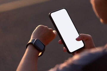 Fototapeta girl's hand holding a smartphone to register about the covid 2019 vaccine obraz