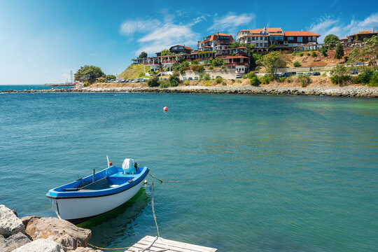old town of nessebar, bulgaria. fishing boat moored on the coast. sunny weather. popular travel destination