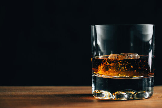Glass with whiskey and ice