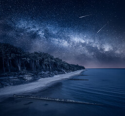 Fototapeta Milky way over Lighthouse by Baltic sea. Beach with stars obraz