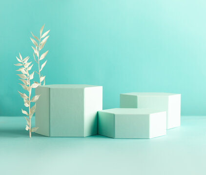 Composition of different geometric objects on pastel mint backdrop. Abstract background with hexagon shape podiums