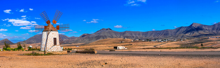 Traditional old windmills and scenic landscape of volcanic Fuerteventura , Canary islands of Spain nature scenery