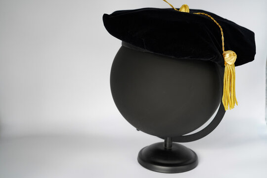 Black PhD doctorate tam cap with gold tassel