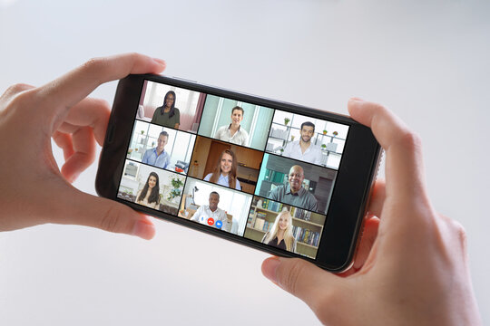 Mobile smartphone screen with multi ethnic group of business people working from home and office, talking to colleagues in webcam group video call conference online technology in quarantine. Team
