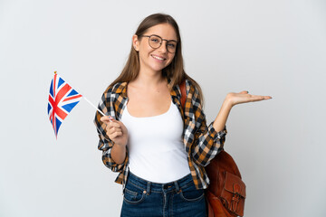 Fototapeta Young Lithuanian woman holding an United Kingdom flag isolated on white background holding copyspace imaginary on the palm to insert an ad obraz