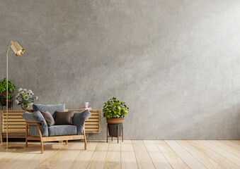 Fototapeta Dark armchair and a wooden cabinet in living room interior with plant,concrete wall. obraz