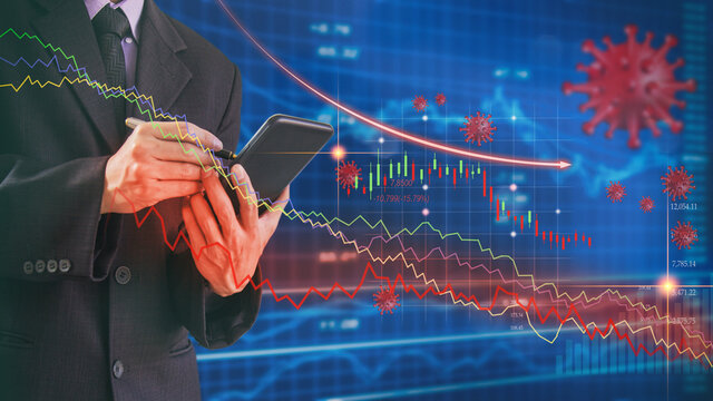 Businessman use mobile phone to analysis stock market and global economy graph due coronavirus or covid-19 crisis. Falling and crash of stock market due coronavirus pandemic. Financial concept.