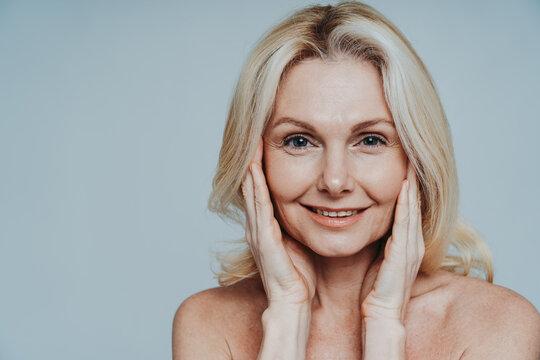 Beautiful senior woman posing on a beauty photo session.