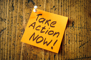 Take action now pinned to desk motivation quote.