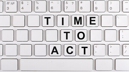 TIME TO ACT text on background keyboard. Business concept