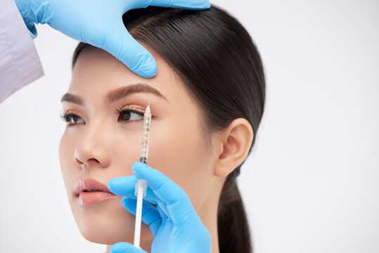 Young woman getting face injections to lift to brows and get rid of wrinkles