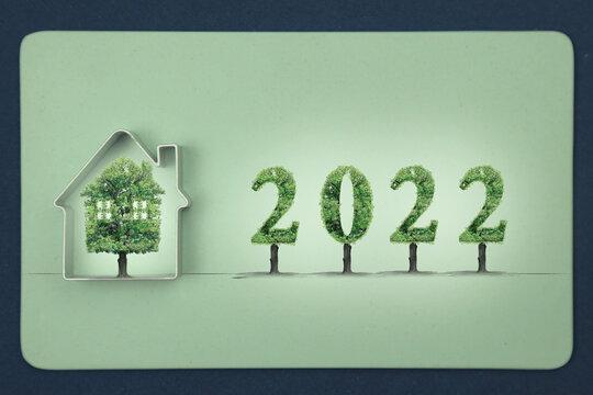 projet immobilier,2022, maison verte, arbre sur fond fond vert