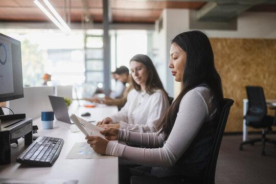 Women reading documents in office