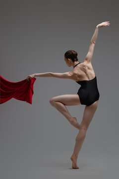 Backview shot of ballerina in tutu with red cloth