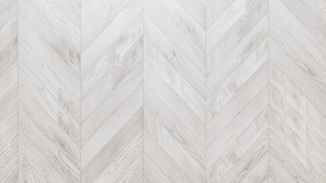 White Wood Background. Wooden Boards arranged in a Chevron Parquet Pattern.
