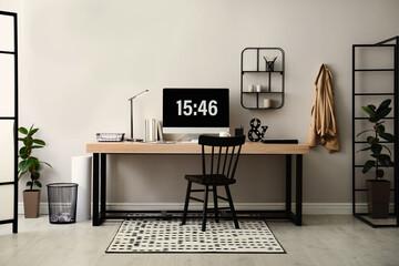 Fototapeta Modern workplace with computer in room. Interior design obraz