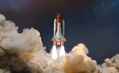 Space shuttle launch in the clouds to outer space. Dark space with stars on background. Sky and clouds. Spaceship flight. Elements of this image furnished by NASA