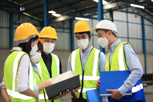 Team workers wear protective face masks for safety industrial factory. worker meeting before start working in factory or warehouse