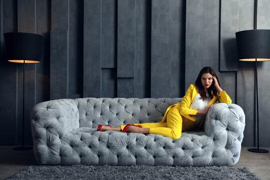 Beautiful businesswoman on sofa indoors. Luxury lifestyle