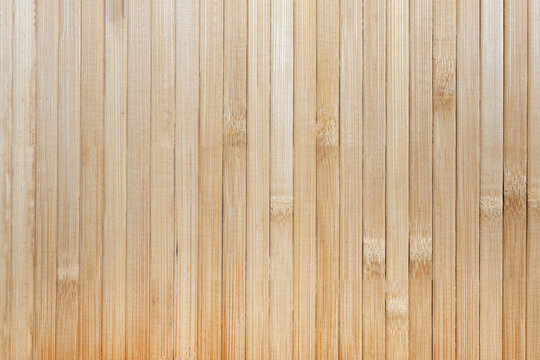 Bamboo texture. Wooden background. Japanese style. Narrow wooden slats held.
