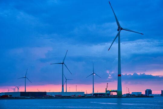 Wind turbines in Antwerp port in the evening