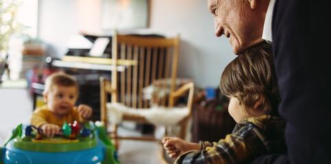 Fototapeta Grandpa with kids at home obraz