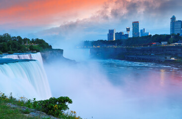 Overview of Niagara Falls with beautiful sunset, Niagara Falls  is a group of three waterfalls at the southern end of Niagara Gorge, in New York State USA