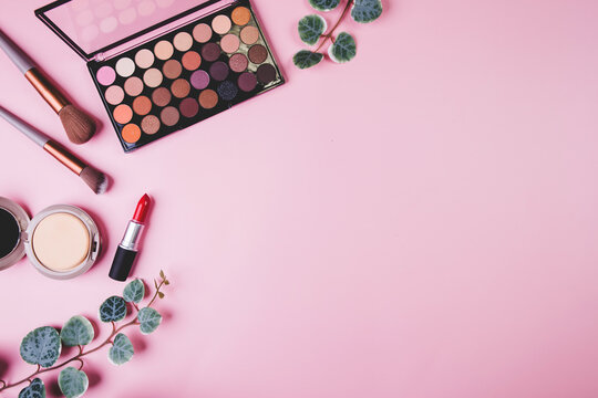 Set of cosmetic makeup tool isolated on pink background, top view, flat lay, brush and lipstick and makeup palette kit, no people, nobody, copy space, group object about beauty, collection make-up.