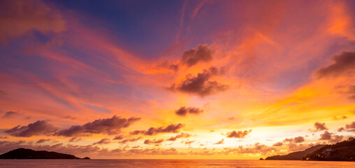 Majestic sunset or sunrise landscape Amazing light of nature cloudscape sky and Clouds moving away rolling colorful dark sunset clouds with reflection in water sea surface Amazing view