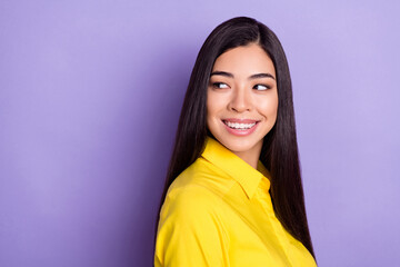 Photo of teacher brown hairdo young lady look empty space wear yellow shirt isolated on purple background Wall mural